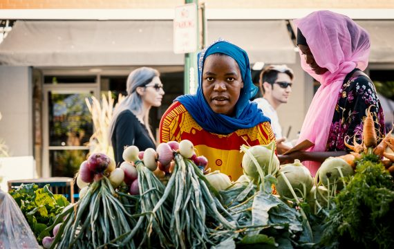 african women in a European market