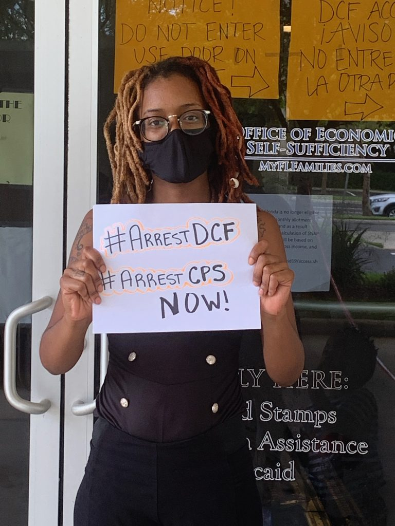 protester outside of sanford florida DCF building